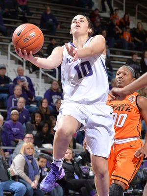 Kansas State Wildcats guard Leticia Romero (10) drives to the basket past Oklahoma State Cowgirls guard Roshunda Johnson (00) during the second half at Fred Bramlage Coliseum. Oklahoma State won 58-51.