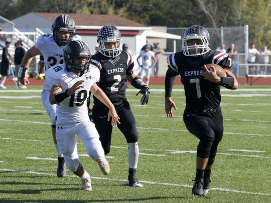 Max Temple carries the ball for Elmira as Corning's Brendyn Hogue gives chase Saturday at Marty Harrigan Athletic Field.