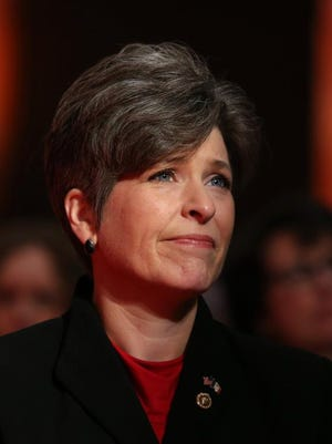 U.S. Sen. Joni Ernst listens during the inauguration ceremony for Iowa Gov. Terry Branstad and Lt. Gov. Kim Reynolds on Jan. 16, 2015, in Des Moines.