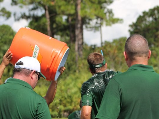 Coach gets a bucket of water.