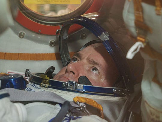Expedition 43 NASA Astronaut Scott Kelly is seen inside the Soyuz TMA-16M spacecraft during the fit check at the Baikonur Cosmodrome in Kazakhstan in this March 2015 file photo.