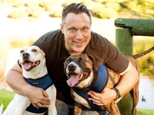 Part-time Palm Springs resident Michael Levitt, producer of the All-Star Dog Rescue Celebration, sits with his rescue dogs Trooper on the left and Nelson on the right.