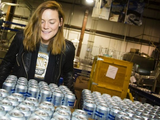 An employee at Oskar Blues Brewery in Brevard prepares canned water for residents of Flint, Michigan. where the governor has declared a state of emergency.