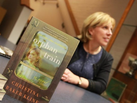 "Christina Baker Kline at a book signing for her popular novel, ""Orphan Train."""