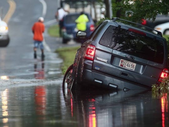 Two cars got stuck in flood waters on Airport Road following a severe thunder storm on Monday.