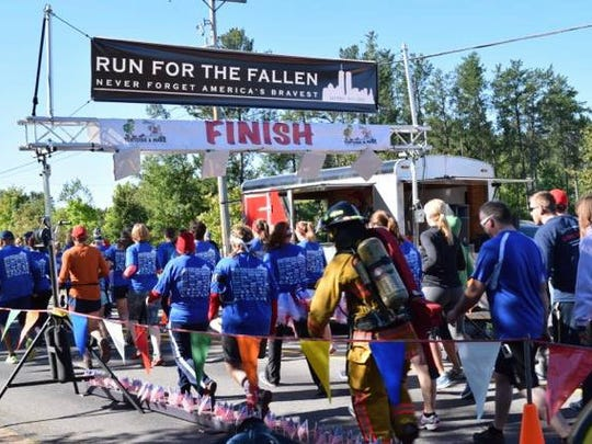 Runners cross the finish line at last year's Run for the Fallen.