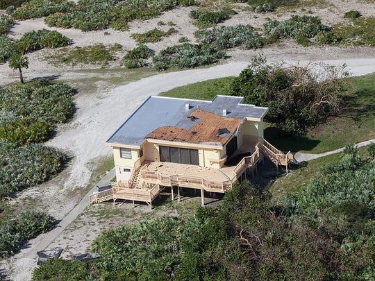 The Beach House is seen during an aerial survey of NASA's Kennedy Space Center in Florida on Saturday. The survey was performed to identify structures and facilities that may have sustained damage from Hurricane Matthew as the storm passed to the east of Kennedy on Oct. 6 and 7, 2016. Officials determined that the center received some isolated roof damage, damaged support buildings, a few downed power lines, and limited water intrusion. Beach erosion also occurred, although the storm surge was less than expected. NASA closed the center ahead of the storm's onset and only a small team of specialists known as the Rideout Team was on the center as the storm approached and passed.