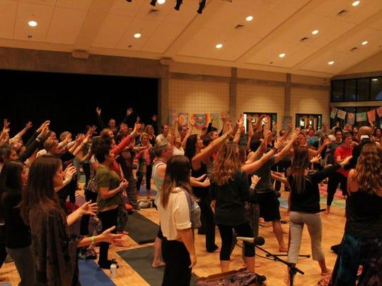Participants enjoy events at a previous Mahabhuta Yoga Festival. This year's festival is Nov. 18-20 at the Sanders Beach - Corinne Jones Resource Center.