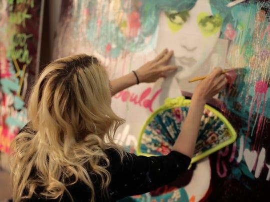 Rader at work in her studio.