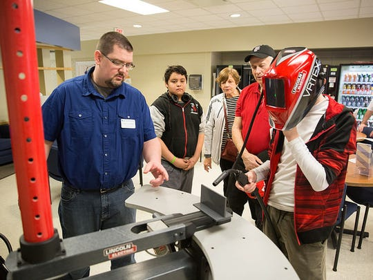 Community members tried out a virtual welder during an open house held Saturday at Moraine Park Technical College.