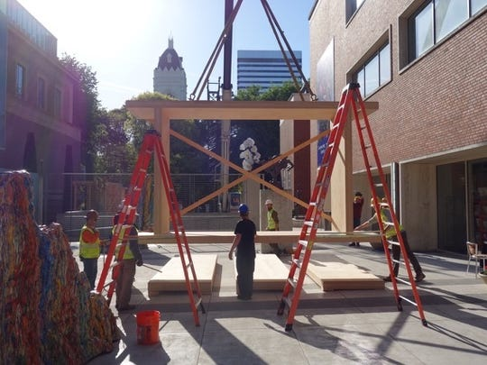 """Erecting a pavilion for Portland Art Museum's """"Quest for Beauty: The Architecture, Landscapes, and Collections of John Yeon."""" Santiam Canyon based Freres Lumber Company manufactured materials for the project, while Kaufman Homes of Salem constructed and provided artistic finish carpentry to the work."""