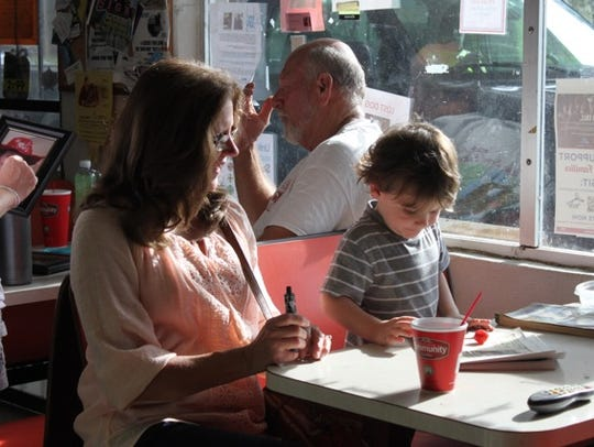Customers enjoy morning coffee at Glenda's Country