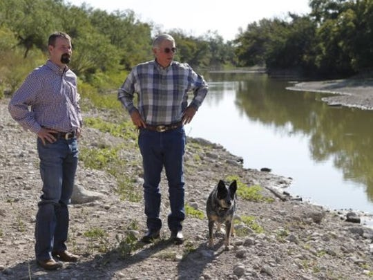 Jeremy Vincent and Roy K. Robb stand on the banks of