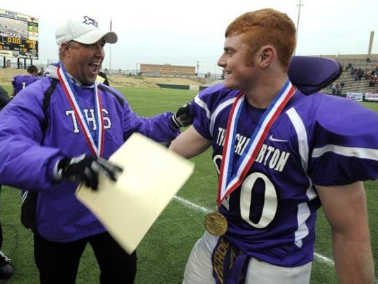 Mike Reed celebrates his first state championship in 2011 while with Throckmorton.