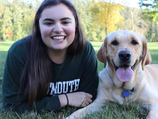 Dartmouth student Staci Mannella and her guide dog.