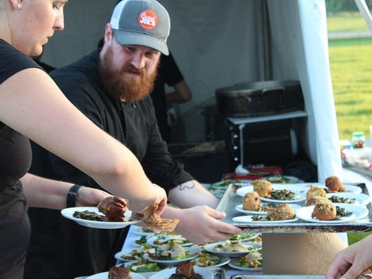 Last year's Farm to Table dinner was prepared by local chef, Tyler Sailsbery, head chef and owner of The Black Sheep in Whitewater, WI.