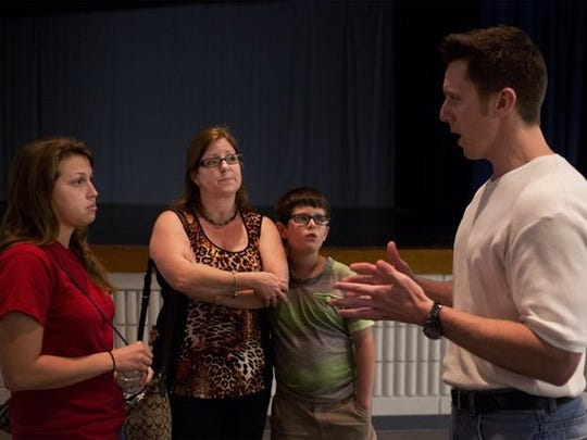 Eric Smallridge, right, speaks to Lisa Roa, center, of Naples, and her children, Emily Arroliga, 21, and Robert Roa, 10, following a talk at Barron Collier High School on March 5, 2015. Eric Smallridge, who hit and killed two women while driving drunk in 2002, spoke about life choices.