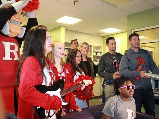 Student-athletes visit patients