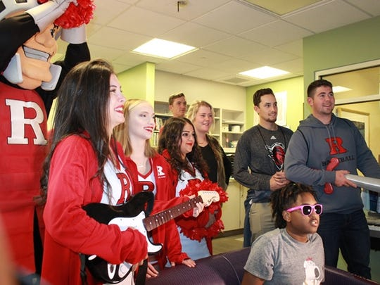 Members of the Rutgers Baseball and Cheer teams and the Scarlet Knight mascot had a blast playing Rock Star with children at Robert Wood Johnson University Hospital in New Brunswick.