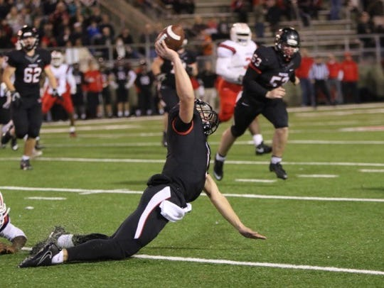 Maryville quarterback Dylan Hopkins is taken down by an Oakland defender during the Class 6A semifinal. What appeared to be an 8-yard sack was called an incomplete pass. The Rebels went on to score on the drive.