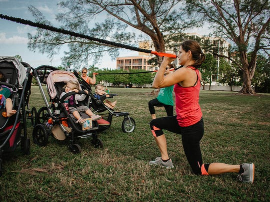 Newborns get a closeup view of their moms doing strength-building exercises in Baby Boot Camp classes.