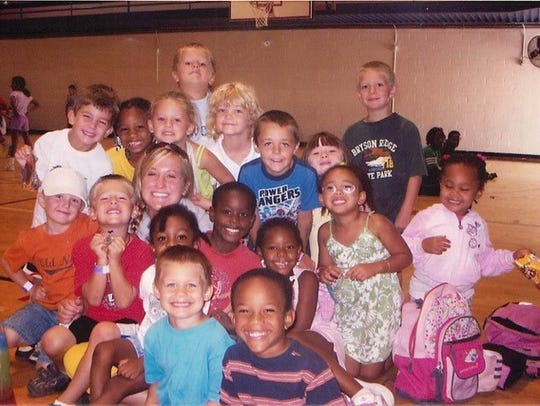 Katie Kokko surrounded by children at the YMCA
