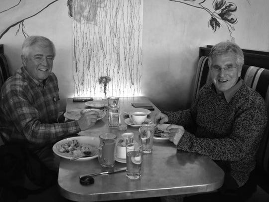 Kevin Devine, left, and Joel Stratte-McClure enjoy lunch at View 202.