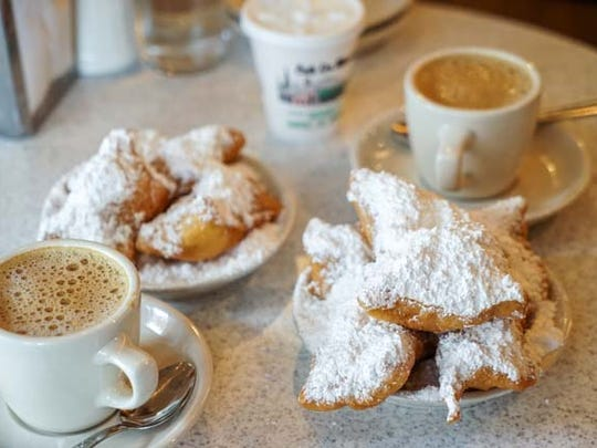 Beignets and chicory-laced cafe au lait from Cafe du Monde in New Orleans.