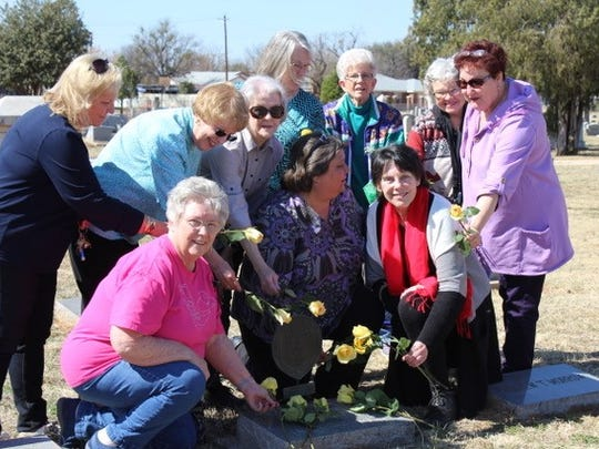Members of the John Davis Chapter place yellow roses on the grave of Mary Houston Morrow, daughter of Sam Houston, to commemorate her birthday and Texas Independence Day. Morrow is buried in the Texas Municipal Cemetery in Abilene and was the city's first postmistress.