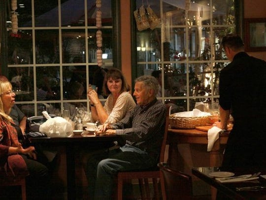 Diners are seen lingering at their table in The Italian Job Cafe dining room. The restaurant will close March 31, after about eight years of business in Oxnard's Channel Islands Harbor.