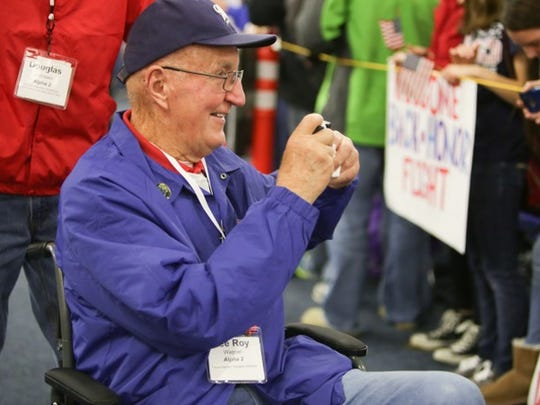 Lee Roy Wagner takes a photo of the crowd that greeted him following a Stars and Stripes Honor flight in November 2015. Wagner died Sunday after suffering a massive stroke a week earlier at Miller Park where he was a parking lot cashier for more than two decades.