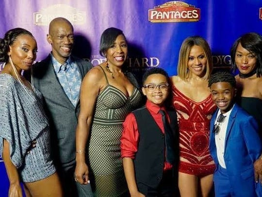 Douglas Baldeo (in blue suit) poses with the Broadway