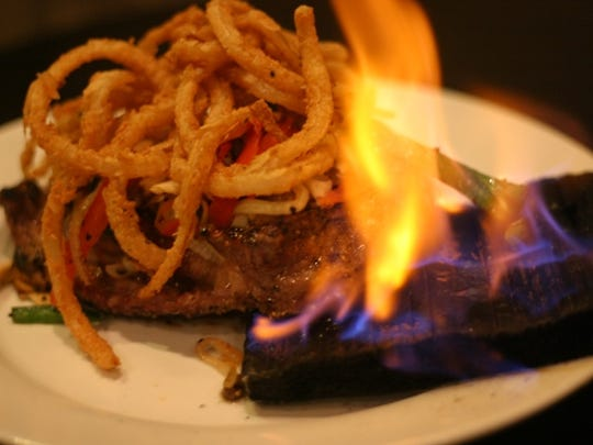 Cedar plank rib eye is a flaming, grilled 16 ounce