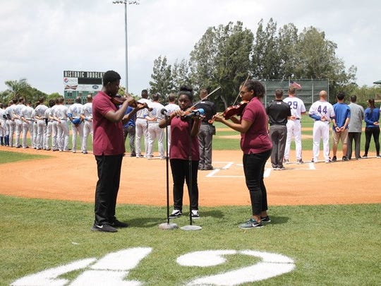 From left: Luke Pelt, Jada Alexandria Powell  and Tatiana Wallace play the National Anthem at the 2018 opening baseball game at the Dodger Stadium.