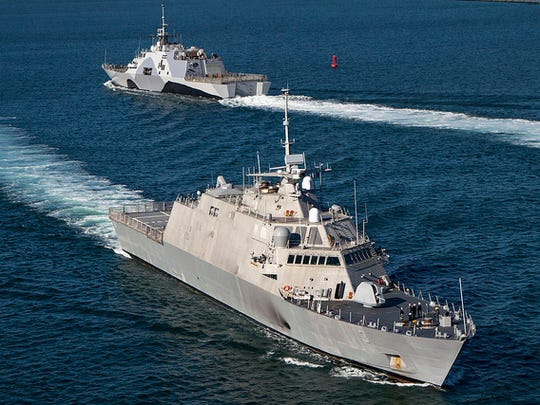 The first two Freedom-variant Littoral Combat Ships, USS Freedom (LCS 1) and USS Fort Worth (LCS 3), off the coast of San Diego in February 2013, prior to USS Freedom's deployment to Southeast Asia.