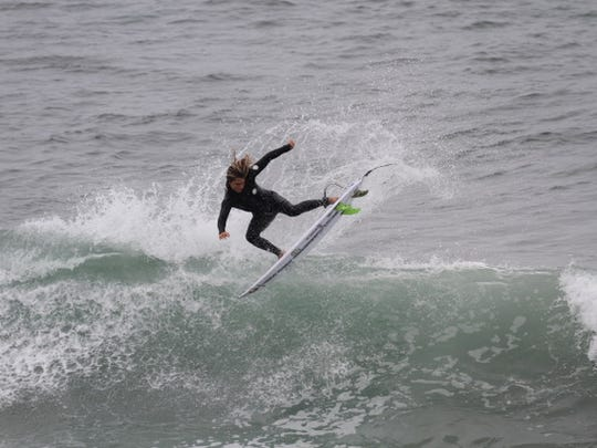 William Hedleston, 14, of Cocoa Beach recently won a major contest in California riding a Kelly Slater-designed surfboard.