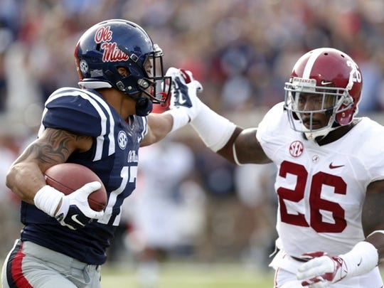 Ole Miss tight end Evan Engram, right, fights off Alabama safety Landon Collins in a game earlier this season.
