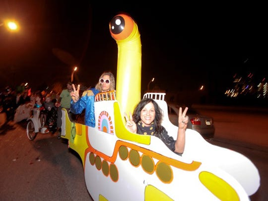 A yellow submarine tooled down the road during the