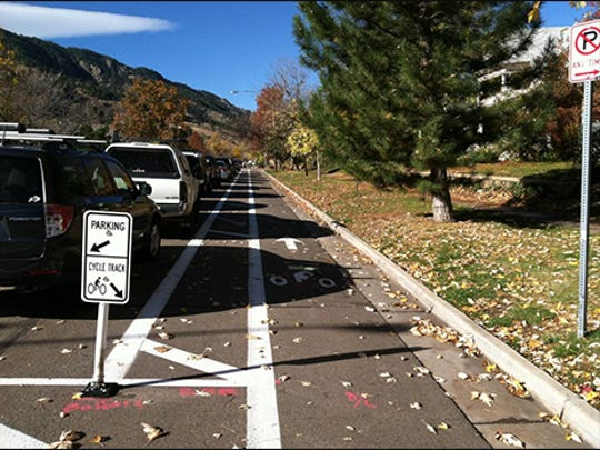 "In 2013, the City of Boulder started a ""Living Laboratory"" program to test new infrastructure options, such as this one, to increase biking, walking and the use of public transit. This project is a parking-protected bike lane that allows for a more comfortable and protected ride adjacent to traffic."