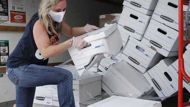 Sarah Edwards, President of Yes on 805, unloads boxes of petitions as the group delivers 260,000 gathered signatures to the Secretary of State's office Monday, June 1, 2020, in Oklahoma City, to put sentencing reform on a 2020 ballot.