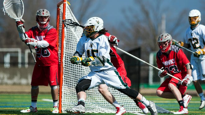 Sophomore Ian MacKay, center, and the UVM men's lacrosse team meets Stony Brook in today's America East semifinals.
