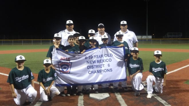 The Carlsbad Shorthorn Green team wins the 8-10 year old New Mexico District 6 championship.