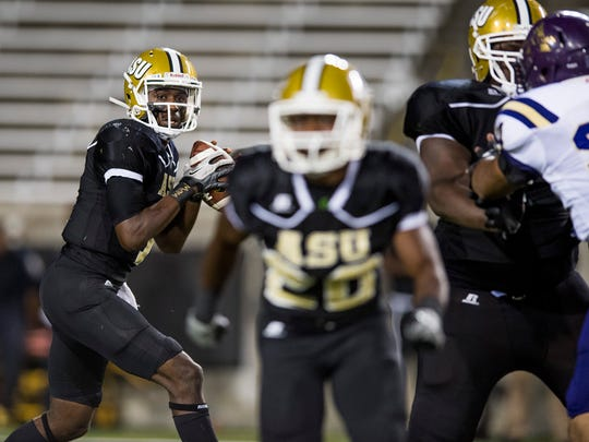 Alabama State's Darryl Pearson, Jr., looks to throw against Alcorn at Hornet Stadium on the ASU campus in Montgomery, Ala. on Thursday October 5, 2017.