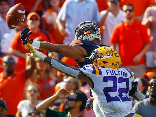 LSU cornerback Kristian Fulton (22) breaks up a pass in the end zone intended for Auburn wide receiver Darius Slayton (81) during the first half of an NCAA college football game, Saturday, Sept. 15, 2018, in Auburn, Ala. (AP Photo/Butch Dill)