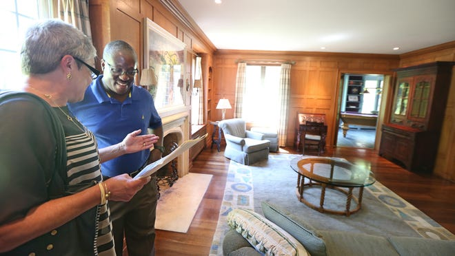 Leslie Rotheschild shows client Scott Gaddy, Albany, around a home on Douglas Rd., off of East Ave. in Rochester Friday, July 31, 2015.