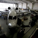 Airplanes inside a large hangar at Pentastar Aviation undergo maintenance at one of their hangars at the Oakland County International Airport in Waterford on Sept. 25. Pentastar Aviation is now also known for interior design of planes looking for an upgrade. Their new interior design studio upstairs at this hangar was officially opened.