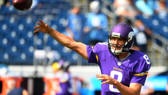 Vikings quarterback Sam Bradford warms up prior to the game against the Titans at Nissan Stadium.