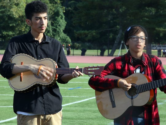 From left, Gerry Cabrera-Colon and Pedro Colon during White Plains High School mariachi band practice at the school.