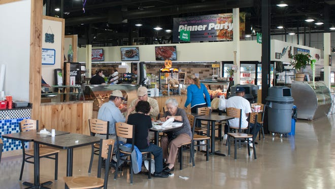 Patrons dine inside the new food court building of Columbus Farmers Market, which was rebuilt after a fire in 2014.
