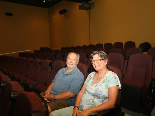 Michael Sodano (left) and Nancy Sabino, co-owners of The ShowRoom Cinema in Asbury Park, sit in one of three intimate theaters located in the restored downtown building.